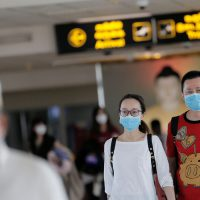 People wearing masks walk at Bandaranaike International Airport after Sri Lanka confirmed the first case of coronavirus in the country, in Katunayake, Sri Lanka January 30, 2020. REUTERS/Dinuka Liyanawatte