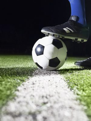 Foot on soccer ball
