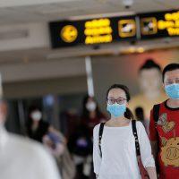 People wearing masks walk at Bandaranaike International Airport after Sri Lanka confirmed the first case of coronavirus in the country, in Katunayake, Sri Lanka January 30, 2020. REUTERS/Dinuka Liyanawatte