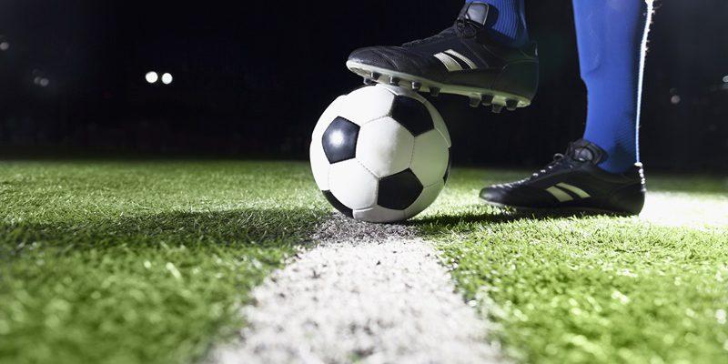 Foot on soccer ball